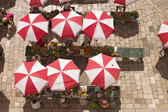 Farmer's Market In Europe. An aerial view of the local farmer's market (Sanitat) in Dubrovnik. The produce is all displayed on tables under the red and white royalty free stock photo