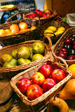 Farmer's Market Fruit Stand with Wicker Baskets Royalty Free Stock Image
