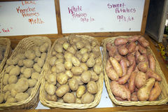 Farmer's Market Potatoes. A display of various varieties of potatoes for sale at market Royalty Free Stock Photos