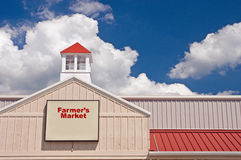 Farmer's Market and sign. A view of a roof line and cupola of a building used as a farmer's market with sign.  Add your own text Royalty Free Stock Photography