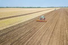 Farmer seeding crops at field. Seeding Aerial View. stock photography