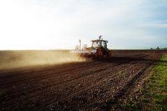 Farmer seeding crops at field Royalty Free Stock Image