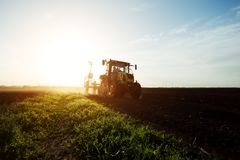 Farmer seeding crops at field Stock Photography