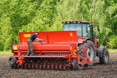Farmer seeding crops at field Royalty Free Stock Photos