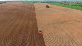 Farmer seeding, sowing crops at field.Aerial view. stock video footage