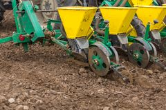 Farmer seeding, sowing crops at field. Sowing is the process of planting seeds in the ground as part of the early spring time agri. Cultural activities Royalty Free Stock Photos