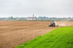 Farmer seeding, sowing crops at field. Sowing is the process of planting seeds in the ground as part of the early spring time agricultural activities Royalty Free Stock Photo