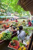 Farmer selling fruit vegetable and food on boats. Royalty Free Stock Photos