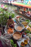 Farmer selling fruit vegetable and food on boats. Stock Images