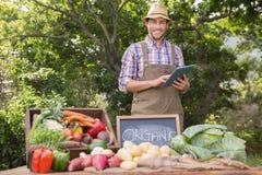 Farmer selling organic veg at market Royalty Free Stock Image