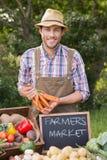Farmer selling organic veg at market Stock Photos