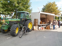 Farmer selling potatoes on a Belgian market featuring his tractor. Halle, Belgium - September 26, 2015: Farmer selling potatoes on a Belgian market featuring Royalty Free Stock Photo