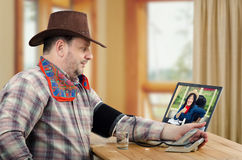 Farmer sending his blood pressure results to country doctor Royalty Free Stock Photography