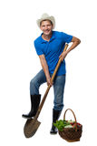 Farmer with a shovel and harvest vegetables stock image