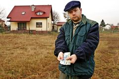 Farmer shoving polish currency Royalty Free Stock Photo