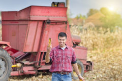 Farmer showing corn cob Stock Photo