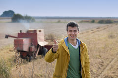 Farmer showing thumb up at soybean harvest Royalty Free Stock Image