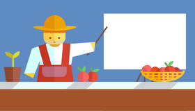 Farmer shows on board Royalty Free Stock Photography