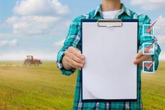 Farmer shows check list . Royalty Free Stock Photo