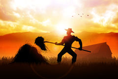 Farmer. Silhouette illustration of a farmer with a pitchfork collecting hay Stock Photos