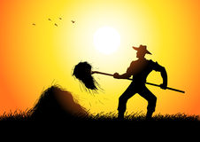 Farmer. Silhouette of a farmer with a pitchfork collecting hay Stock Photos