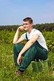 Farmer sitting in field Stock Photography