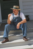 Farmer sitting on porch Smoking a pipe Stock Photos