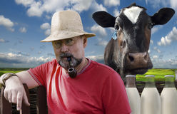 Farmer with a smoking pipe in a pince-nez Stock Images