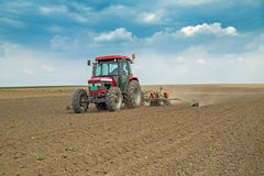 Farmer sowing corn maize crops Royalty Free Stock Photography