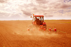 Farmer sowing crops at field. Filtered image to emulate xpro look Stock Photo