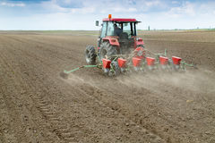 Farmer sowing crops with pneumatic seeding machine Royalty Free Stock Images