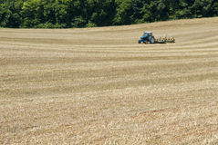 Farmer Sows Seed For Second Hay Crop Royalty Free Stock Photos