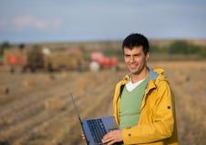 Farmer with soybean bale Stock Photos