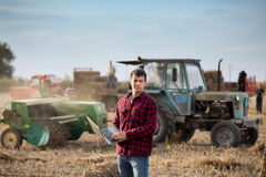 Farmer with soybean bale Stock Photos