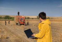 Farmer with soybean bale Stock Photography