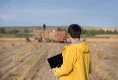Farmer with soybean bale Stock Images