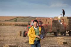 Farmer with soybean bale Stock Image