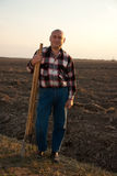 Farmer with spade and pitchfork Royalty Free Stock Image