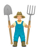 Farmer. With spade and pitchfork on a white background Royalty Free Stock Photos