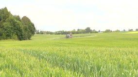 Farmer spray crop field at summer season, herbicides, pesticides stock footage