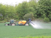 Farmer spraying chemicals in the fields Royalty Free Stock Photo