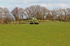 Farmer spraying field Stock Image