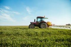 Farmer spraying green wheat field.  Stock Photography