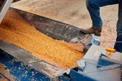 Farmer standing on agricultural equipment stock photo