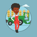 Farmer standing with combine on background. African farmer standing on the background of combine harvester working in field. Farmer and combine harvester Royalty Free Stock Images