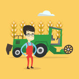 Farmer standing with combine on background. Royalty Free Stock Image