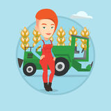 Farmer standing with combine on background. Stock Images