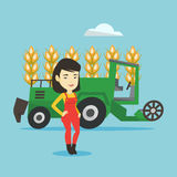 Farmer standing with combine on background. Royalty Free Stock Images