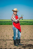 Farmer standing in a corn field Stock Images