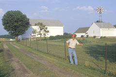 A farmer standing by a fence Royalty Free Stock Image